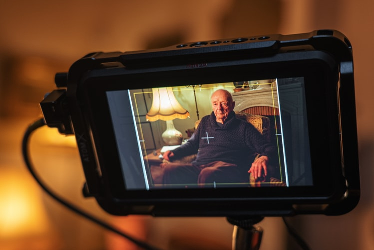 video-screen-showing-a-man-being-interviewed